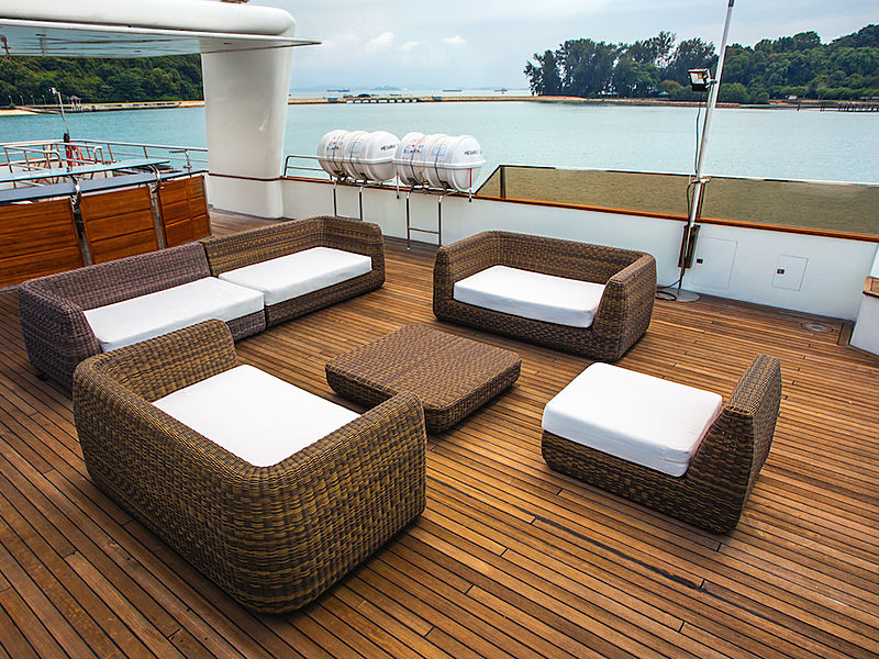 yacht upper deck area with wooden floors and several couches