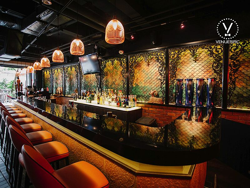 patterned wall bar counter in singapore with yellow pendant lights