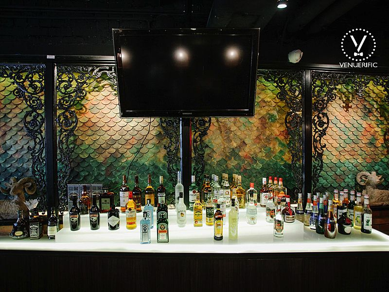 drinks display on white bar table with television