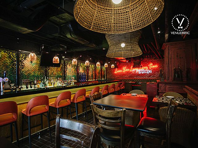 small event space in singapore with pendant lamps covered with rattan