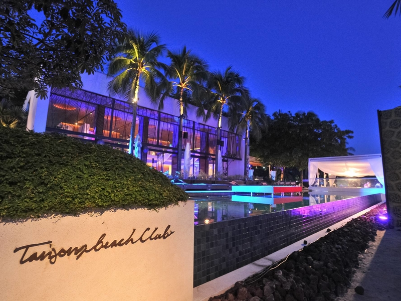 party space in singapore with outdoor pool and trees surrounds