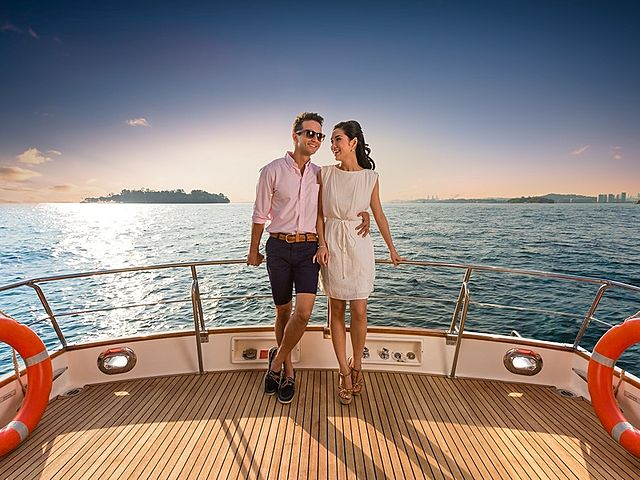 a couple standing and hug each other on the yacht