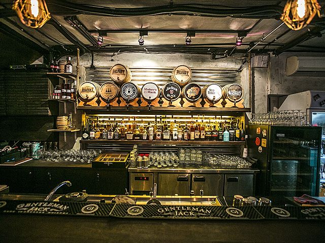 singapore bar counter with whisky barrel display