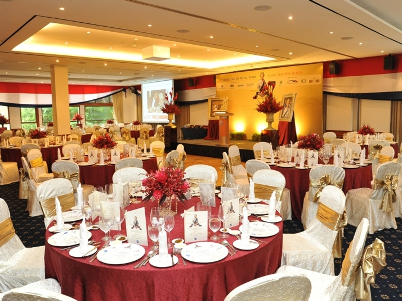 singapore dinner and dance venue with round tables and mini stage