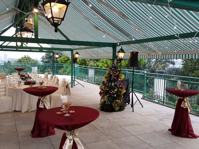 christmas rooftop party in singapore with cocktail table and decoration