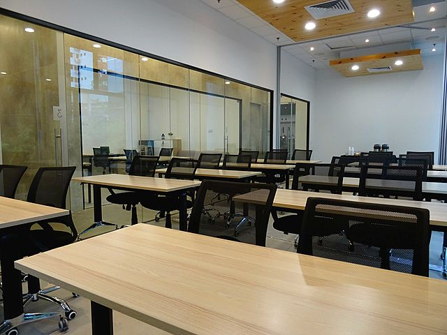meeting room with classroom layout and glass wall