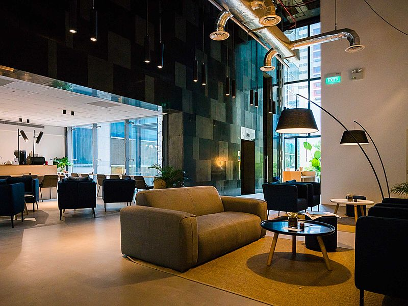 event space lounge with couches and floor lamps