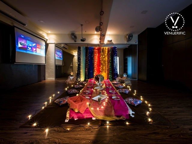 singapore event space decorated with screen and low table for candle light dinner