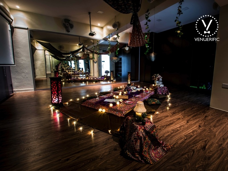 singapore intimate wedding space with wooden floors and decorated low table