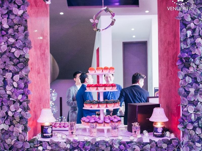 colourful networking event venue in singapore with buffet dishes