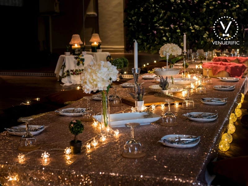 singapore dinner and dance event space with decorated dining table and candle lights