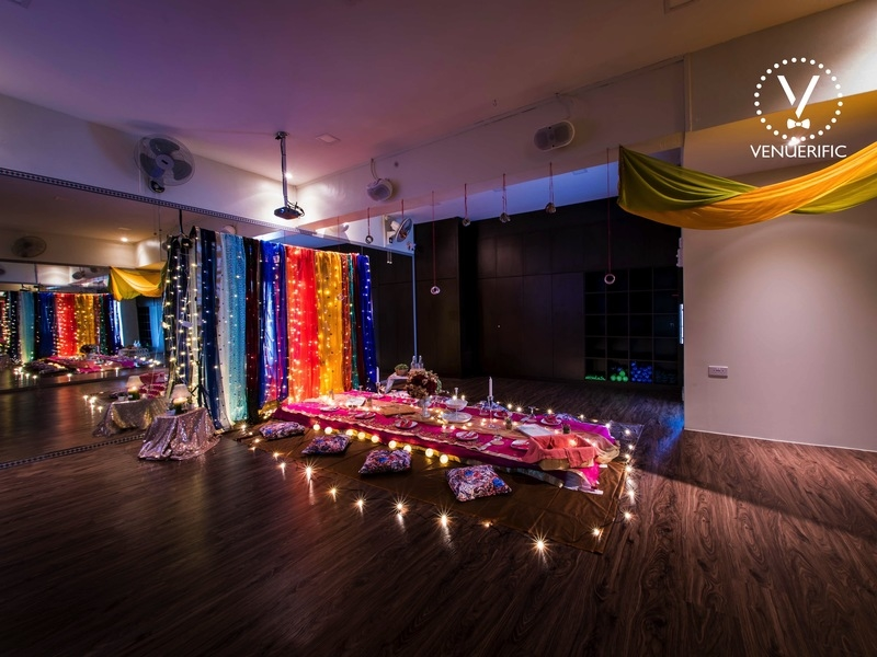 large multi-function room in singapore decorated with colourful dining table and backdrop
