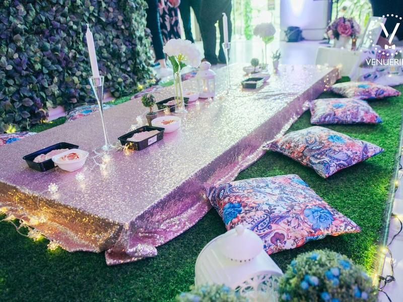 bohemian style venue in singapore with floral table decorations