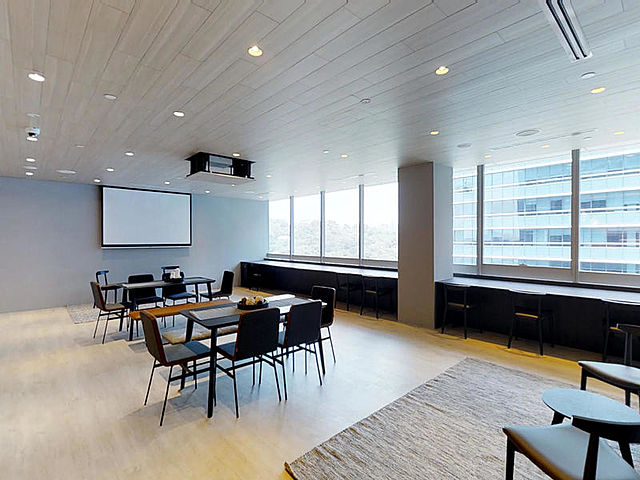 corporate event space with screen projector