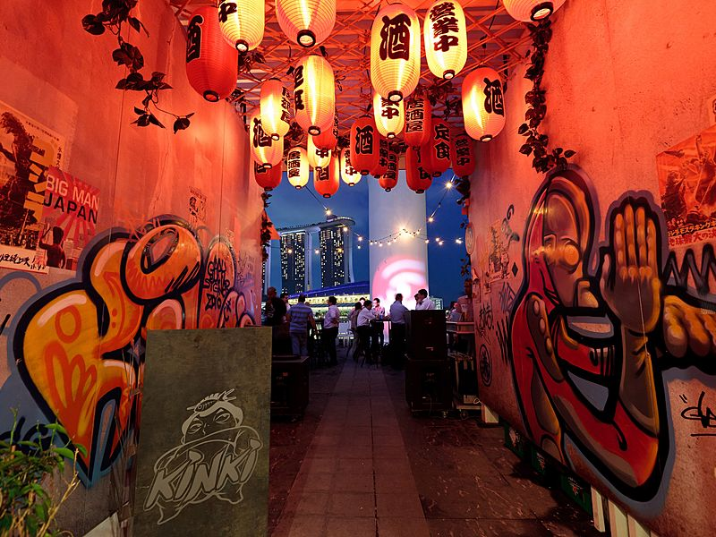 mural graffiti with red lighting from japanese lampion