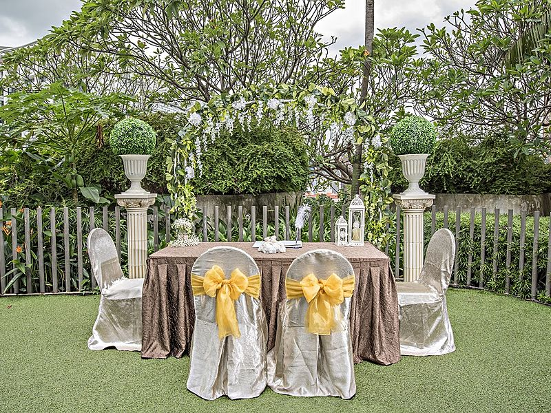 garden solemnisation event venue with bride and groom chairs