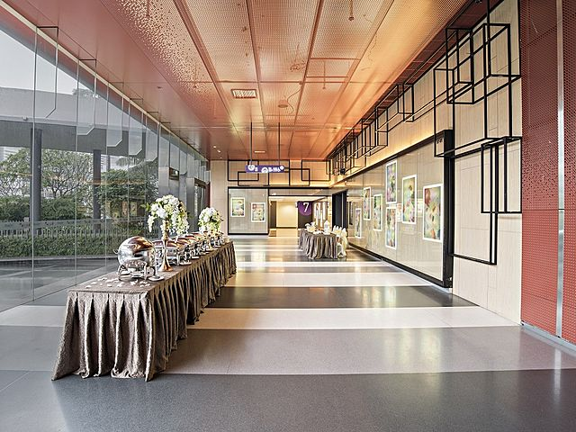 hallway event space with buffet table and glass wall