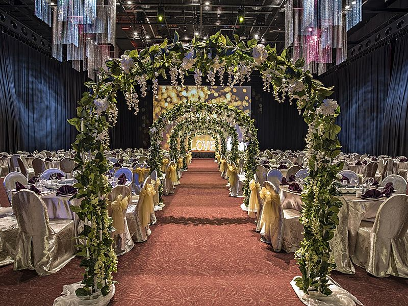 wedding aisle decorated with flowers and red floors