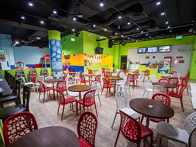 mini round table and chairs in playgrounds waiting room