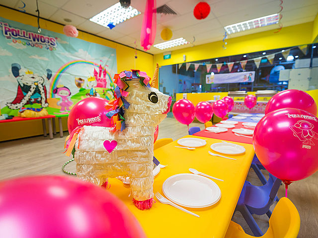 a horse pinata on a yellow table in singapore kids birthday party room