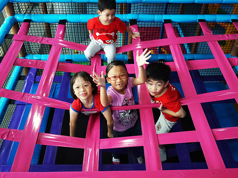 kids playing together in playground pink nets