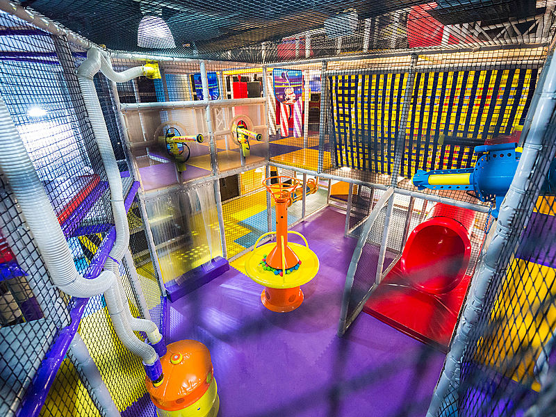 two floors kid's playground with black safety nets around it