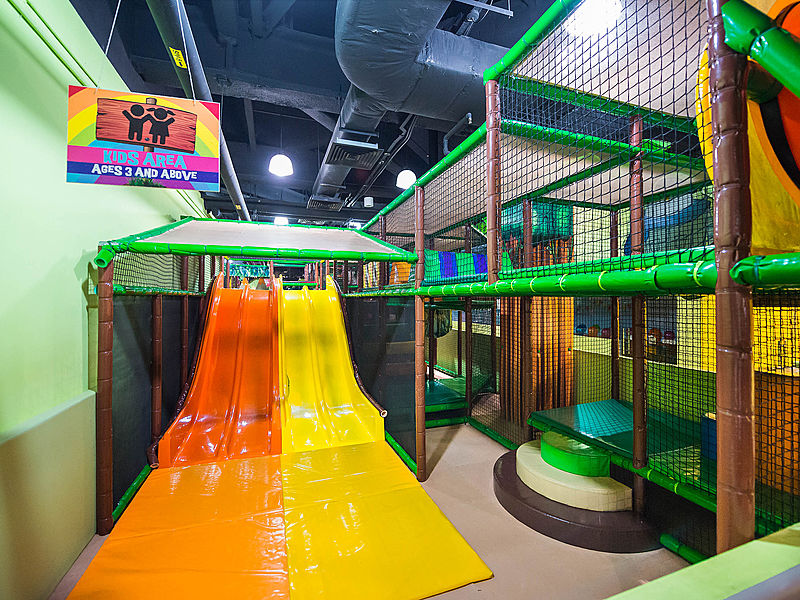 two colourful slides in indoor kids playground