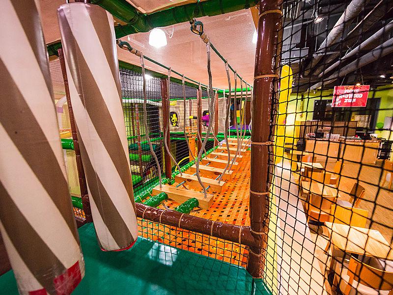 kids playground suspension bridge with safety nets around it