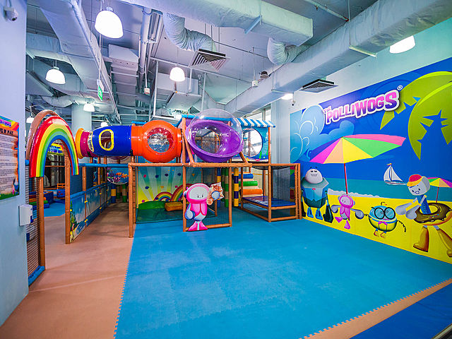 indoor kids playground with beach wallpaper