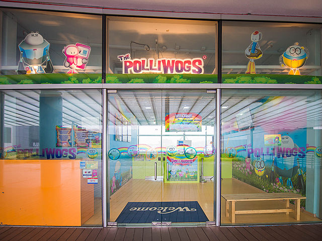 the polliwogs vivocity frontage with glass doors and cartoon stickers