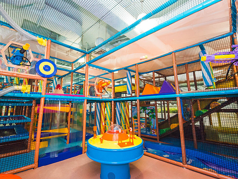medium size kids playground with black safety net