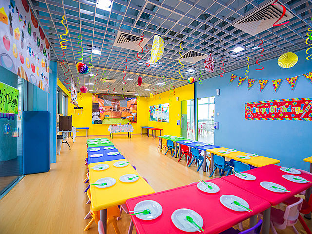 kids birthday venue decorated with colourful u-shaped seating