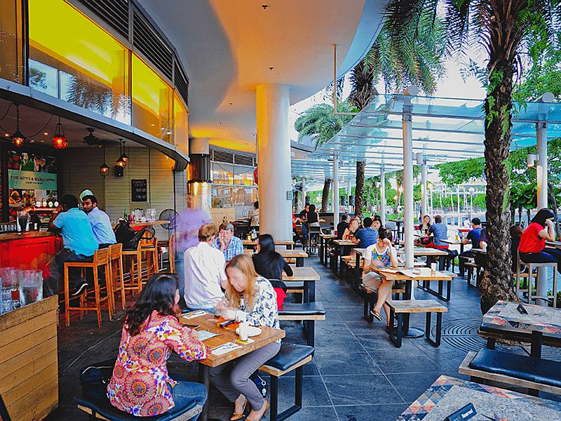 harbourfront singapore restaurant with outdoor areas and glass roof