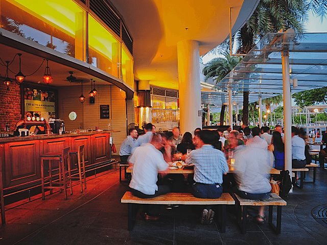 crowd sitting in restaurant outdoor space