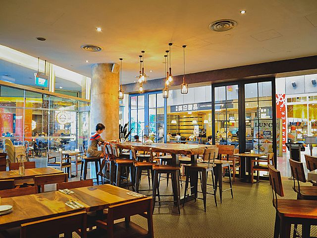 glass style restaurant with bar stools and pendant lamp