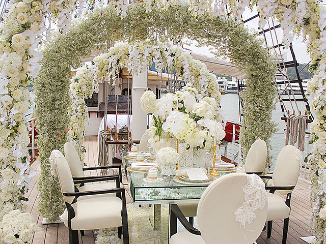 intimate wedding table decorated with white floral