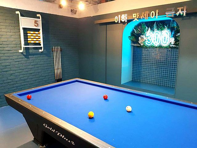 cafe's multifunction room with pool table