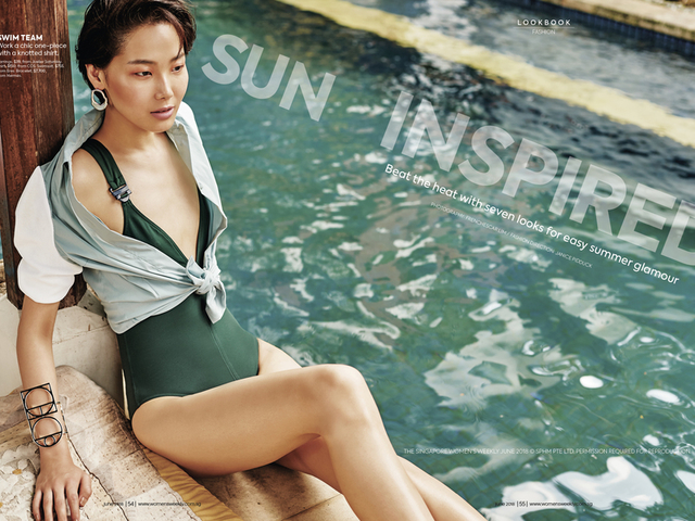a woman sitting in poolside
