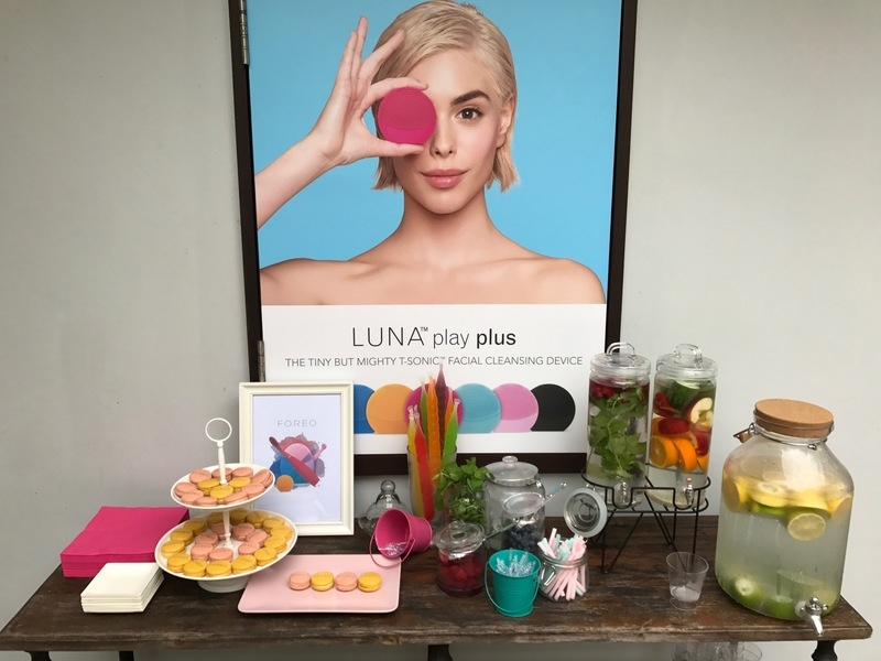 product launch space with dessert table and event poster