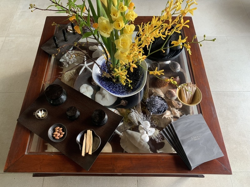 square table with tea and flowers on it