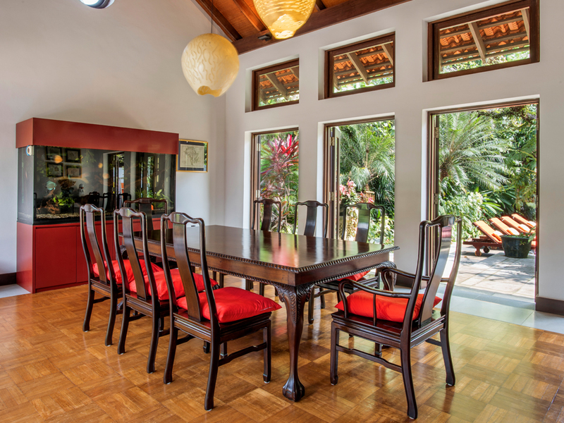 dining room with wooden ornament and three large doors