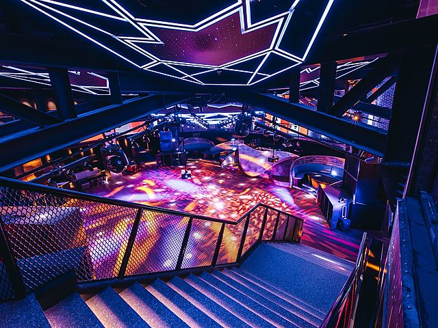 a ladder that connects directly to the dance floor