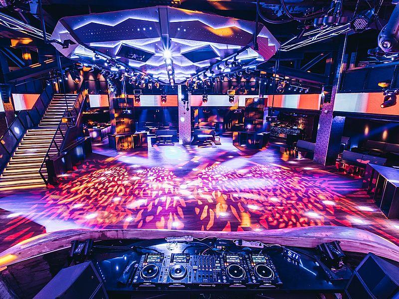 dj equipment in front of large dance floor