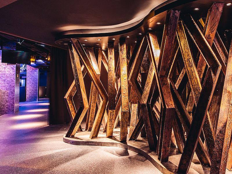 a hallway with wooden installation art as decoration
