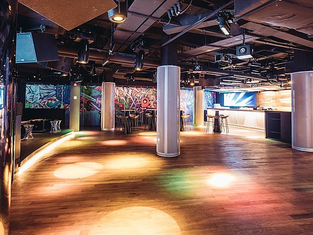 dance floor with wooden floors and several large white pillars
