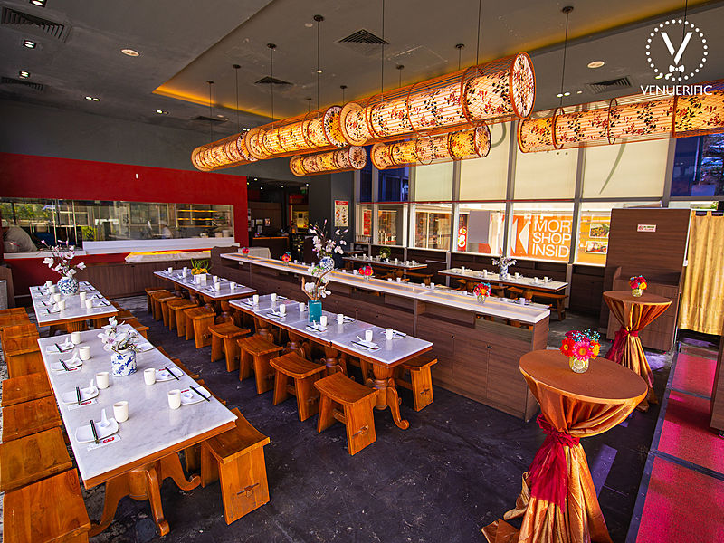 restaurant with grey ceiling and brown tube pendant lamp