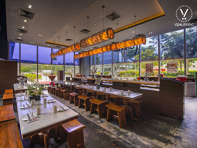 singapore seminar event venue with a long table arrangement for dining