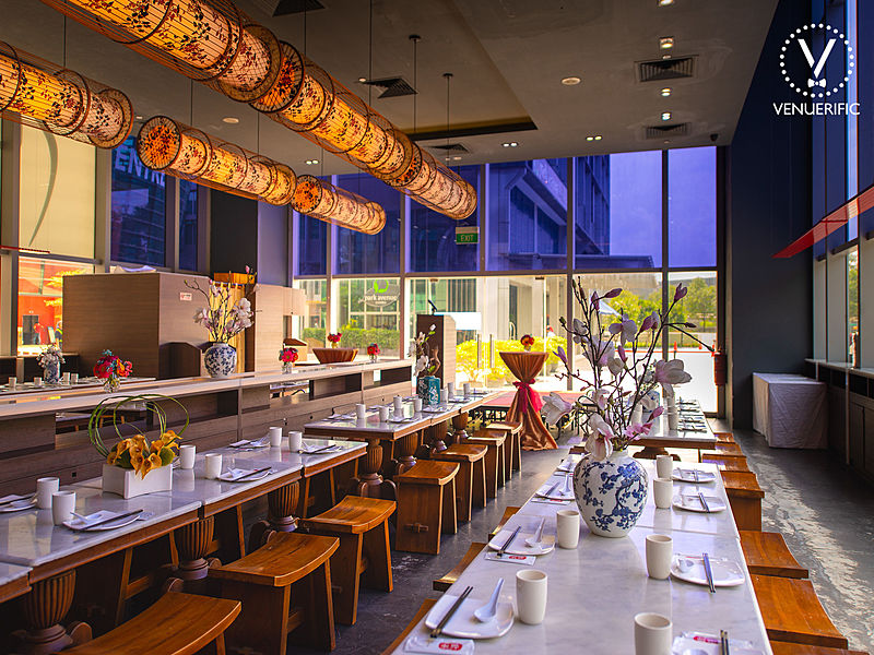 asian cuisine restaurant with long white dining table