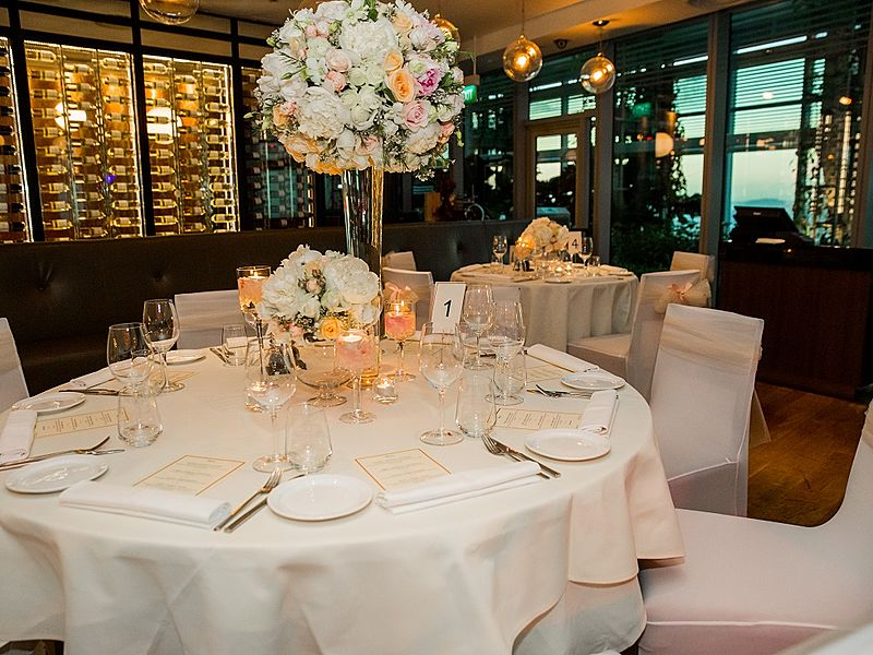 intimate wedding party room with fine dining table setting