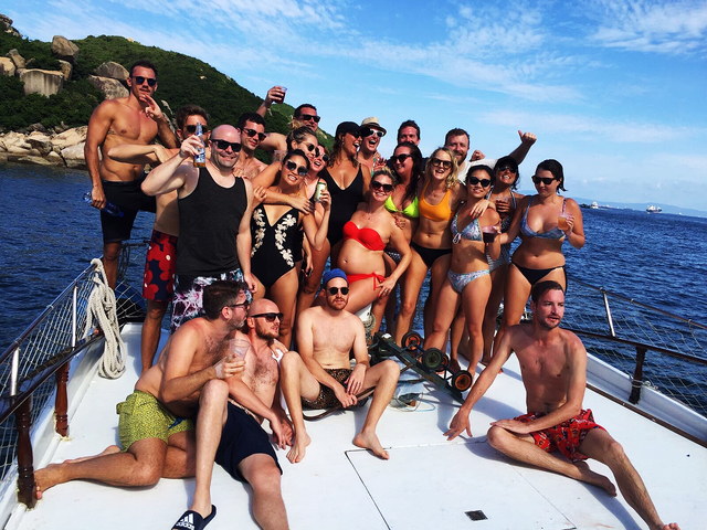 people are enjoying their private party at the yacht